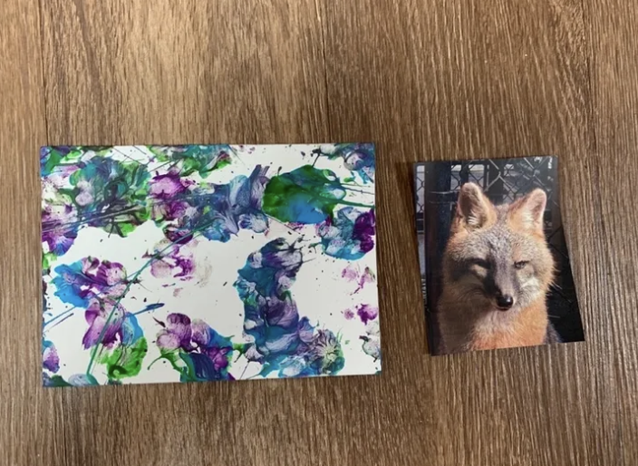 Purple and blue abstract paw art with photo of gray fox