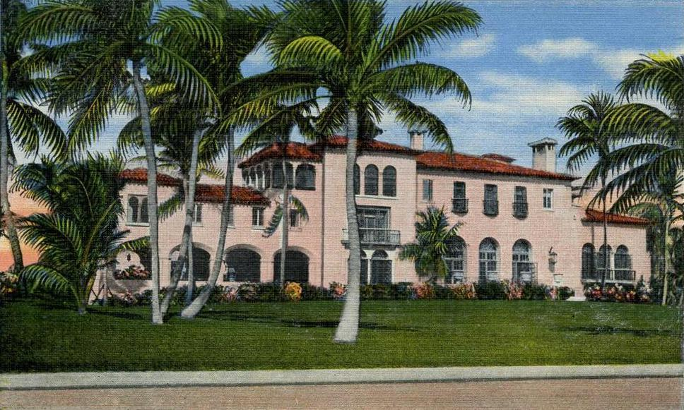 postcard of historic pink mansion with palm trees