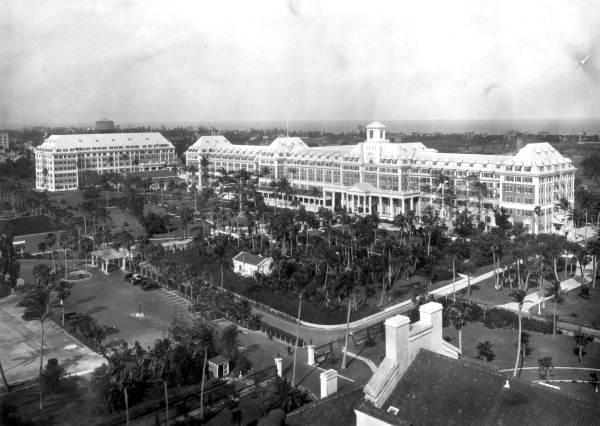 Black and white photo of massive white Victorian era hotel