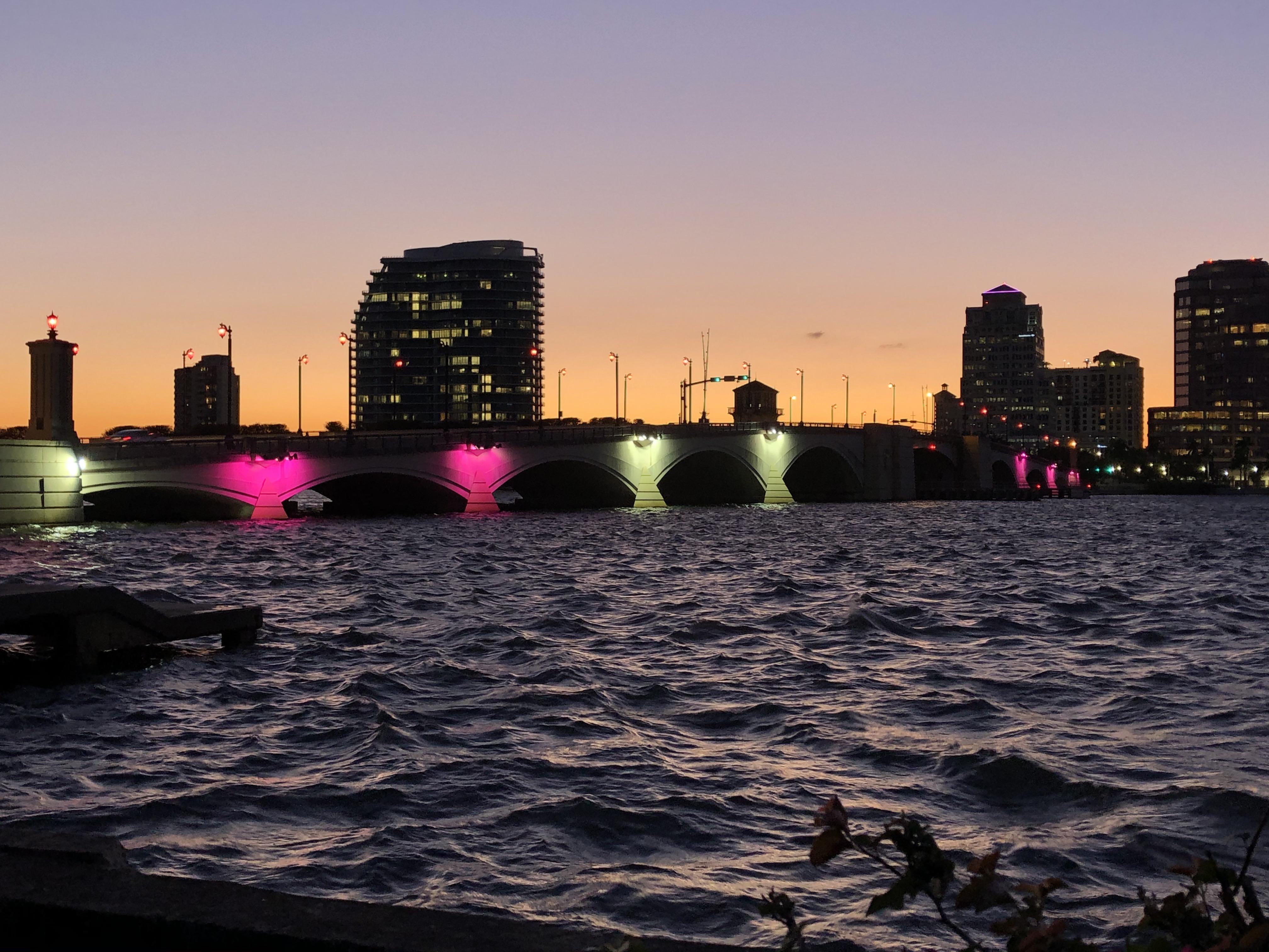 Royal Park Bridge lit pink against a sunset sky