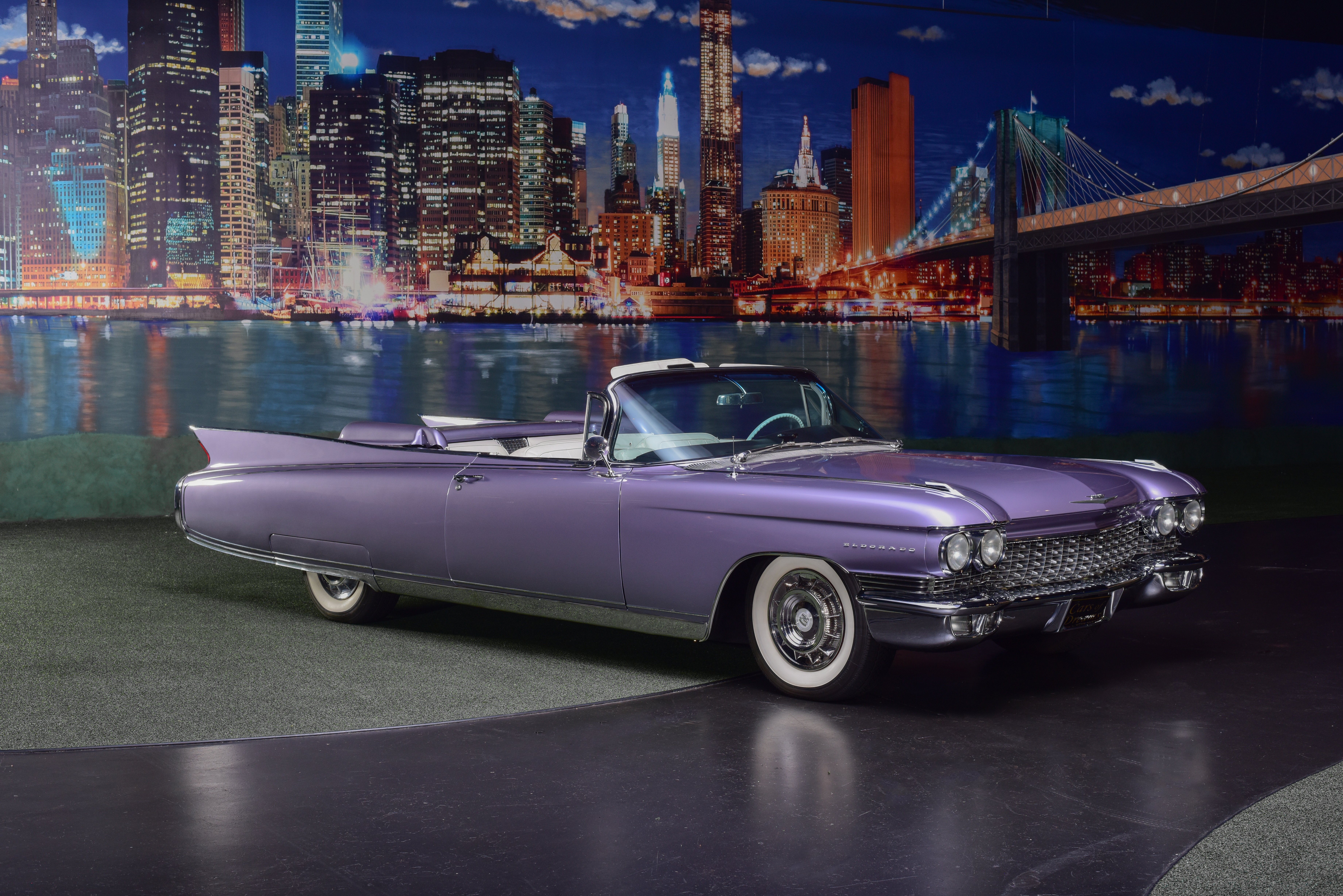 Barrett-Jackson Palm Beach offering shows beautifully restored classic 1960 purple Cadillac Eldorado Biarritz Convertible with whitewalls