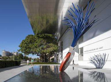 Large red and blue sculpture outside museum