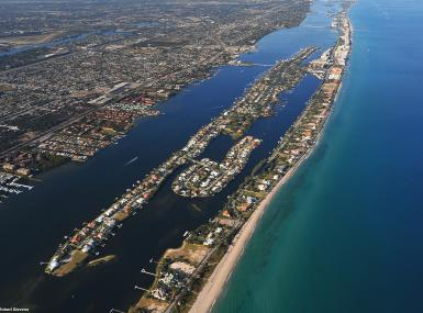 Aerial view of island of Palm Beach flanked by aqua ocean and navy intracoastal waterway on either side