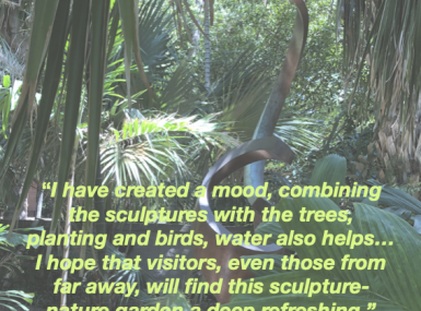 Tropical plants provide backdrop for metal sculpture with quote from Ann Norton
