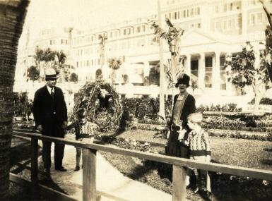 Affluent family outside large hotel in Palm Beach Florida 1929