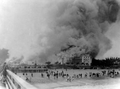 Black and white 1925 photo of The Breakers hotel fire from beach
