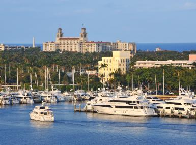 Photo of yachts at marina with Breakers Hotel and ocean behind