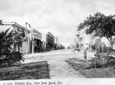 Black and white photo Clematis Street in 1890's with dirt road and shops