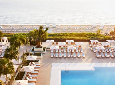 Four Seasons Palm Beach pool with lounge chairs with beach and ocean in background