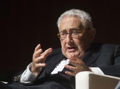 Henry Kissinger on stage speaking