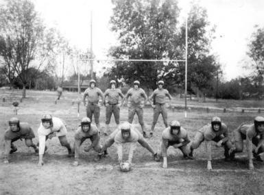 Black and white photo of high school football team circa 1941