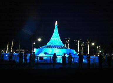 Giant Christmas tree sand sculpture light up turquoise at night