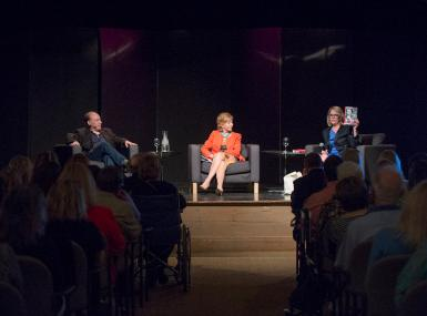 Panel members discuss a book on stage during the 2016 Palm Beach Book Festival
