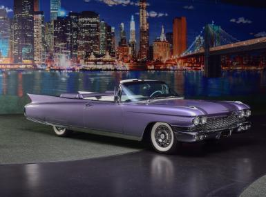 Barrett-Jackson Palm Beach offering shows beautifully restored classic 1960 purple Cadillac Eldorado Biarritz Convertible with whitewalls