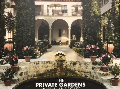 Book cover of private garden in Palm Beach features pond with coral stair case, arched hedges and red tile roofed home in background