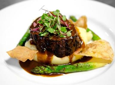 Steak filet on mashed potatoes with asparagus and gravy